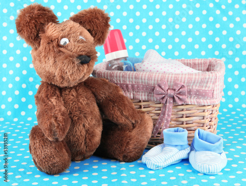 Beautiful basket of baby clothes on a blue background