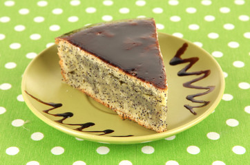 Delicious poppy seed cake on table close-up
