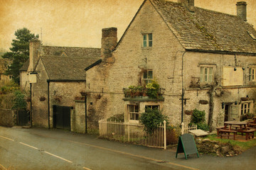 small cafe in Bibury, Gloucestershire, England.   Paper texture.
