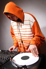Hip hop DJ scratching the music record