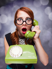 Redhead women with green telephone.