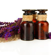Medicine bottles and salvia flowers, isolated on white