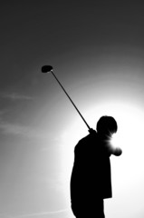 Silhouette of a Man Swinging a Golf Club