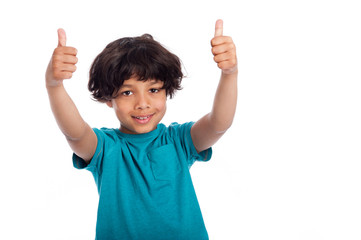 Cute mixed race boy with thumbs up pose, isolated in studio.