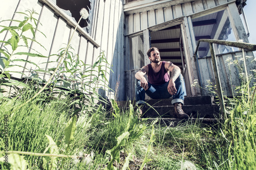 Punk rocker sitting on staircase