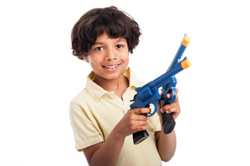 Beautiful Mixed Race Boy Playing with Toy Guns