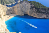 beautiful white beach with shipwreck in a greek island
