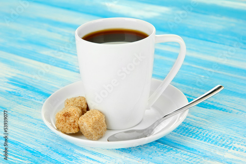 Cup of coffee, on color wooden background