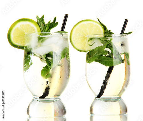 Glasses of cocktail with ice isolated on white