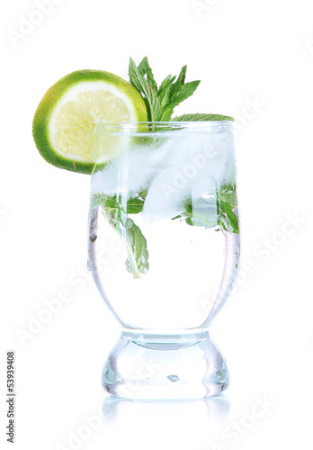 Glass of cocktail with ice isolated on white