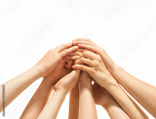 Successful team: many hands holding together
