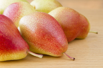 Close up image of forelle pears on wooden table