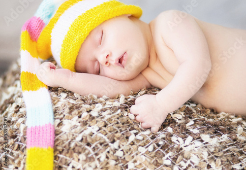 Picture of sleeping baby with woollen cap