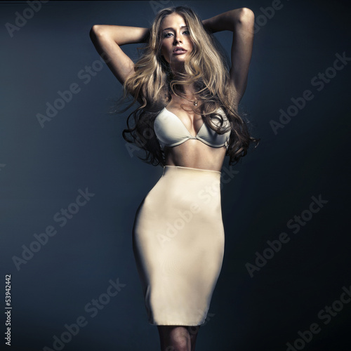 Shapely blonde lady with long hair