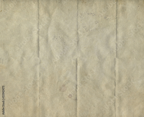 Shabby folded old paper texture, vintage background