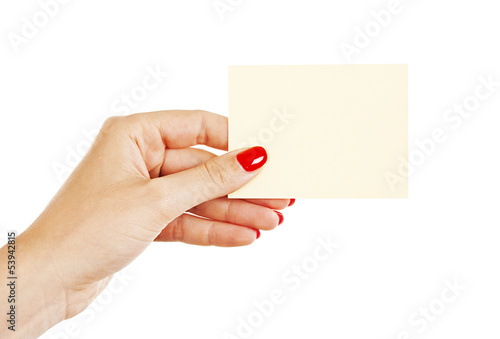 Female hand with red nails holding a blank card