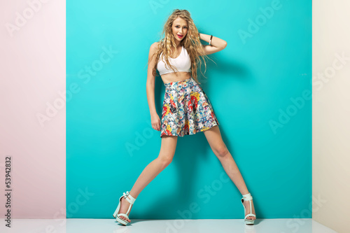 Trendy outfit of young blonde girl
