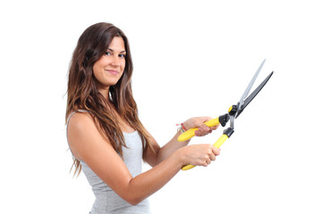 Beautiful woman holding a pruning shears