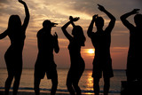 Silhouette Of Friends Having Beach Party