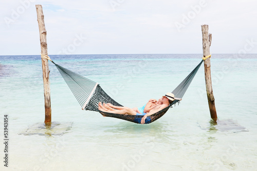 Senior Couple Relaxing In Beach Hammock