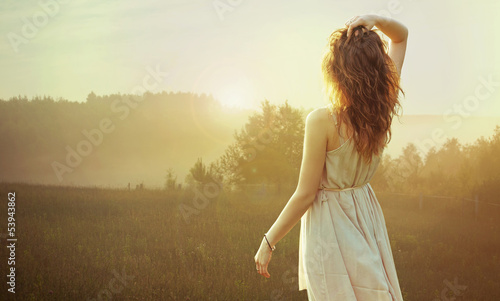 Pretty brunette woman watching the sunset