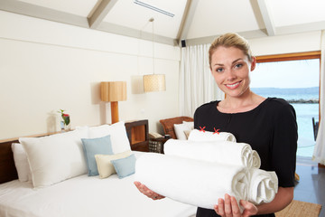 Portrait Of Hotel Chambermaid With Towels