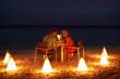 Senior Couple Enjoying Late Meal In Outdoor Restaurant