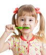 child girl cleaning teeth , isolated on white background