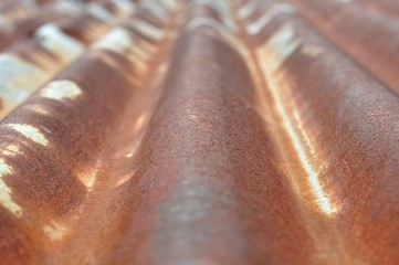 Detail view of old rusty corrugated metal sheet