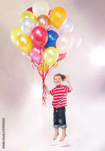 Cute small kid hovering by the ballons