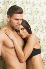Sexy passionate heterosexual couple embracing