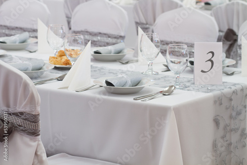 decorated chairs and wedding table number three - 53950031