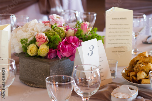 table set for wedding dinner decorated with flowers