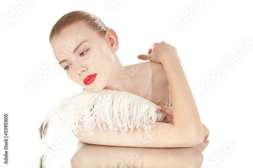 Portrait of a beautiful woman with white feather over white