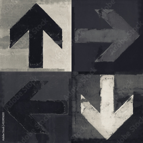 Four arrows signs painted on a wall, grunge design arrows set © lava4images