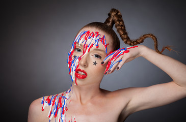 Girl with braid and artistic makeup posing