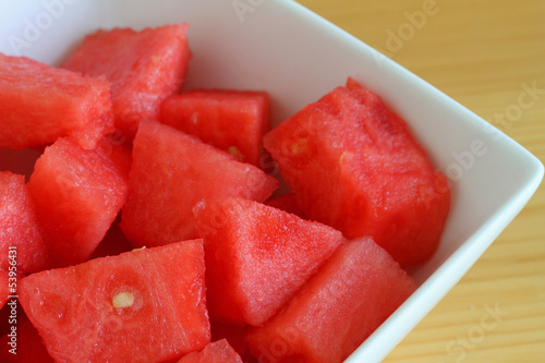 Watermelon cubes in white bowl, close up