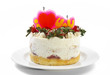 butter cream cake with strawberry & candle on plate