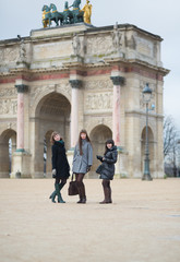 Three joyful girls together in Paris