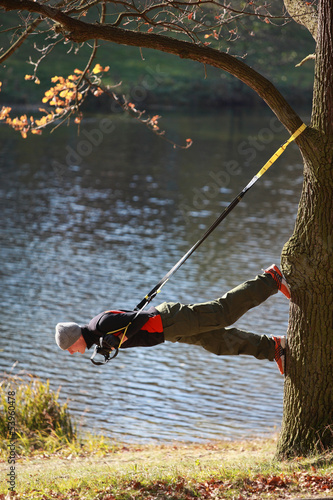 suspension training at the river  - man on tree