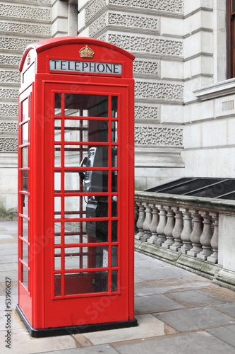 British red phone box on a London street - 53960627