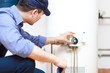 canvas print picture - Plumber repairing an hot-water heater