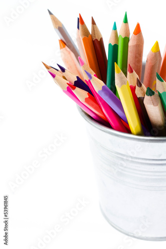 Color pencils in tin can or pencil  holders and green apple, bac