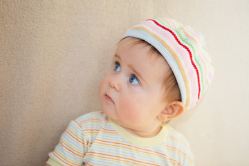 cute baby girl in a striped beret