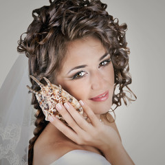 Young beautiful bride woman in wedding dress and luxury coiffure