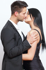 Cute and elegant couple kissing each other