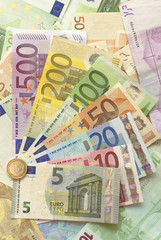 Euro Bills with Euro Coin