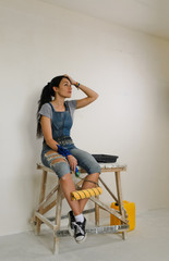 Woman taking a break from painting