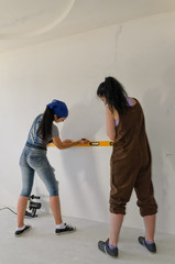Two girls using a spirit level