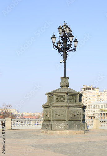 Ancient lantern on the background of the Moscow Kremlin.